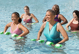 Women taking a water aerobic class in an outdoor pool