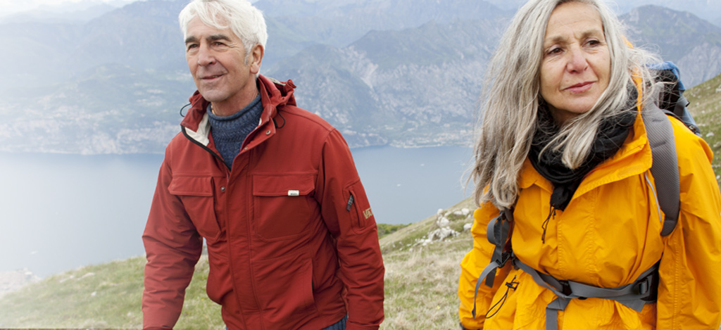 Senior couple hiking in mountain range, Italy, Monte Baldo